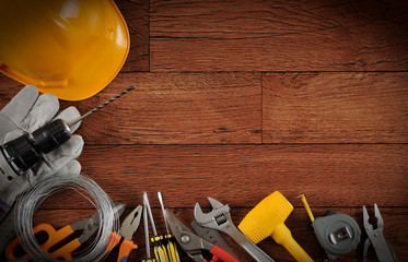 Construction equipments on wood background with copy space.
