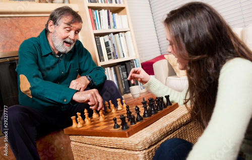 Senior playing chess