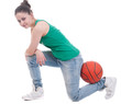 Beautiful young basketball woman in studio