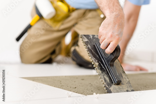 Home improvement, renovation - handyman laying tile