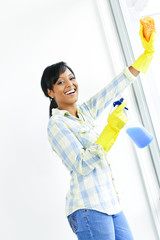 Smiling woman cleaning windows
