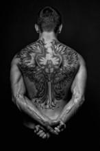 Moael z aniołem tatuaż
