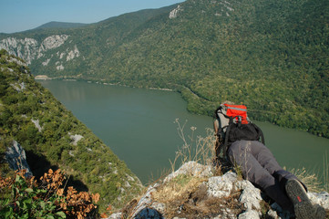 Girl looking down to Danube river. Romania