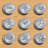metal buttons on wooden background