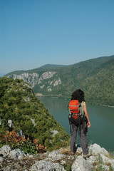 Girl looking down to Danube river, Cazanele gorge, Romania