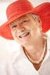 Closeup portrait of senior woman wearing hat