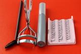set for eyelashes, mascara, tongs, brush poster