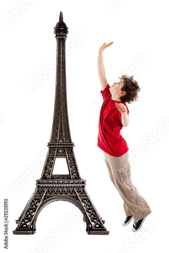 Eiffel tower and boy jumping isolated  on white