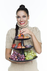 Young woman holding fruit dish