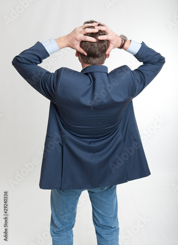 Rear view of a desperate man