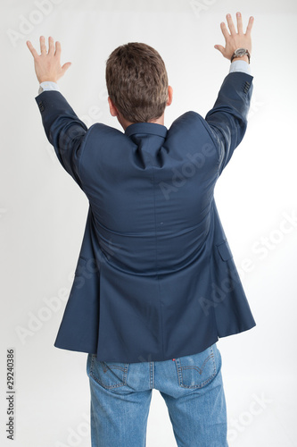 Rear view of man extending his hands