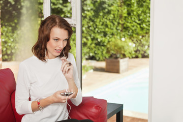 Young woman using iPhone