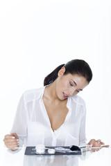 Young woman looking at cosmetics display