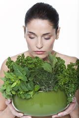 Young woman holding fresh herbs