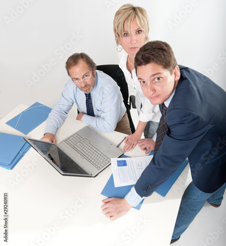Three people at work