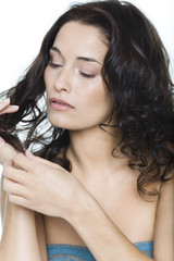 Young woman touching her hair