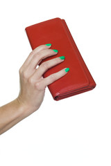 Close-up of woman's hand holding red purse