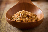 Pile of soy granules in wooden spoon poster