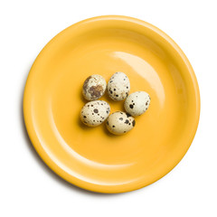 quail eggs on yellow plate