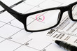 1040 tax form with calendar glasses and pen