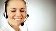 Smiling call center woman with headset, grey background