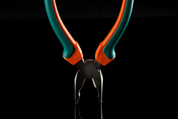Metal flat-nose pliers with rubbed grips