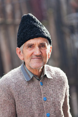 Portrait of an old rural man outdoor