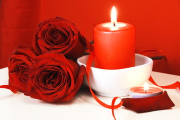 Burning Candles and Red Roses