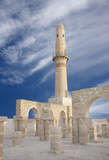 Restored minaret with archway, Khamis mosque poster