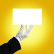 butler holding white card