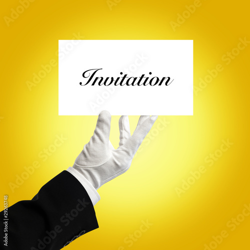 Butler holding invitation card