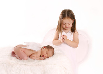 Sister praying over newborn angel