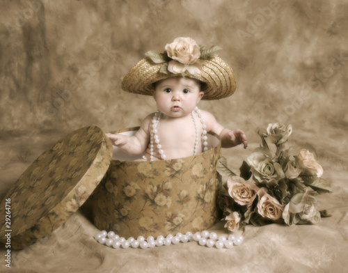 Baby girl in vintage hatbox