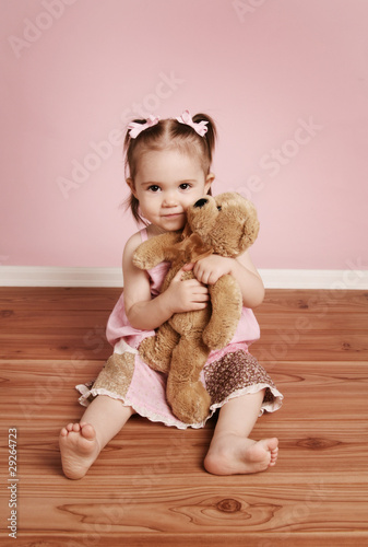 Cute little girl and teddy bear