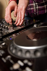 Hands of a Dj performing