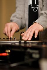 Hands of a DJ playing vinyl