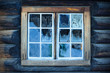 Window of a traditional Norwegian hut with beautiful frostwork