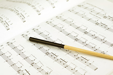 Conductor's baton on sheet music