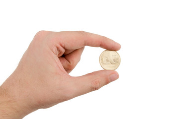 Hand Holding Gold Coin Between Fingers
