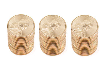Three Stacks of Gold Coins Isolated on White Background