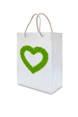 green grass love heart on white paper bag isolated