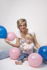 Mother and daughter portrait with balloons