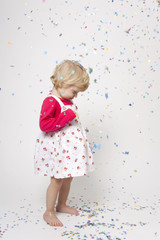 Cute girl with confetti