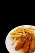 Hot Chicken Wings and Fries Isolated on Black Background