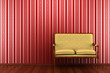 yellow classic sofa in front of red striped wall