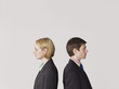 Business people standing back to back, on white background