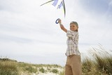 Girl Flying Kite at Sand Dunes