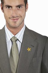 Businessman with gold star on suit, portrait