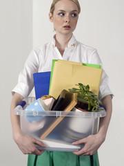 Office worker carrying personal belongings, indoors