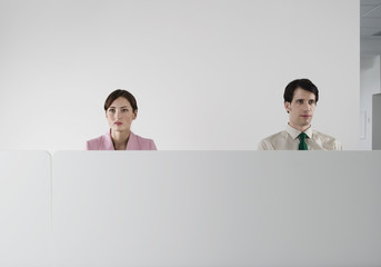 Office workers behind cubicle wall
